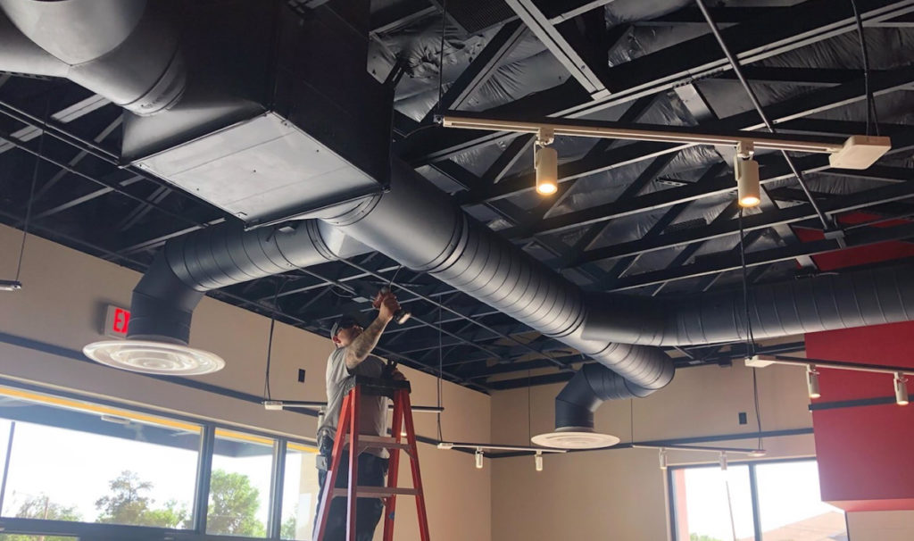 Duct Work - GregWS – Greg Lomas installing exposed duct work at the Wienerschnitzel in Carlsbad