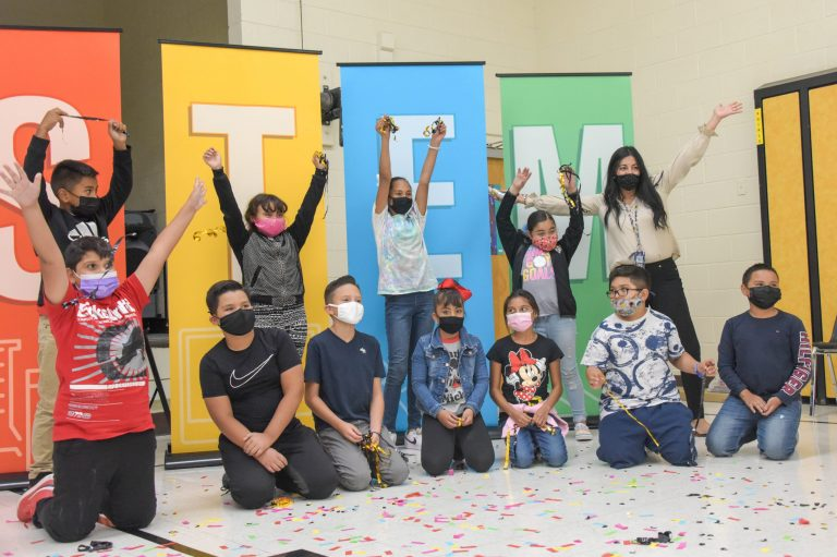 Students cheer as the Jefferson Elementary School STEM Center officially opens
